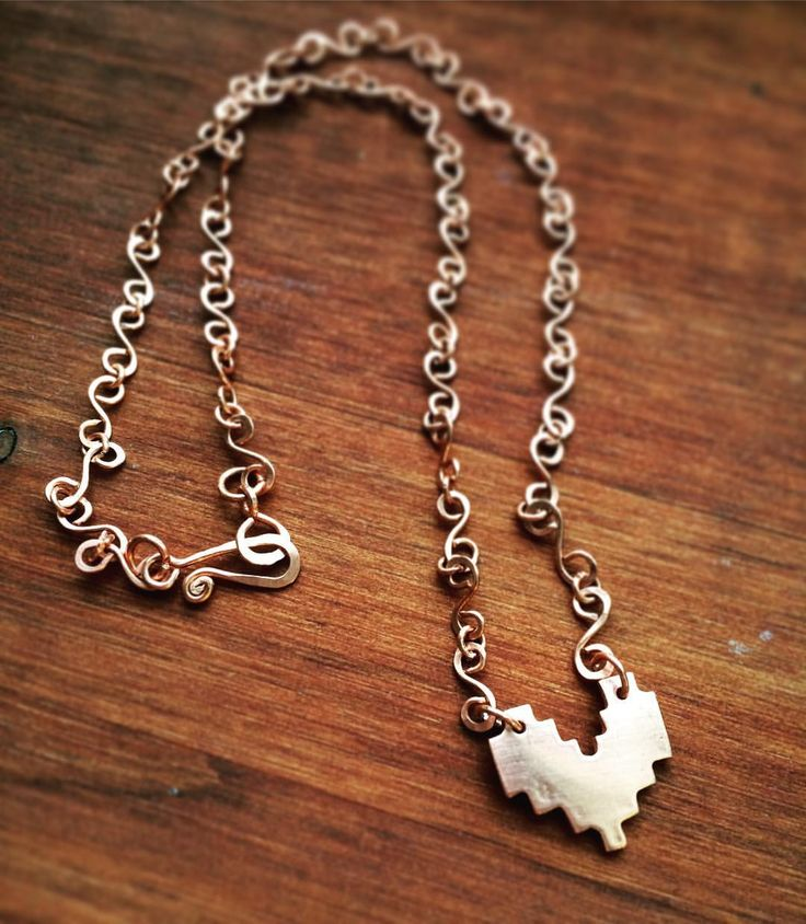 8-bit heart copper necklace - handmade by me in my own little jewelry studio (more like corner in my room). Every jewelry i do is unique and created from what i'm inspired to do in that moment. I used copper clay to make the pendant, which was fired in my jewelry kiln. The chain and hook-and-eye clasp is also handmade from scratch with some of my jewelry tools and pure copper wire.