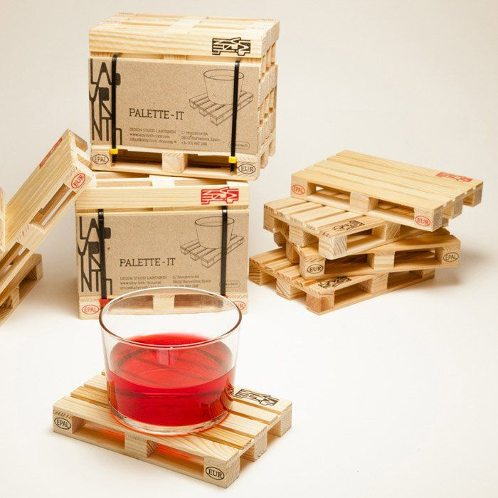 """This cute and original miniature pallet will be the star of all your social events!!! The classic pallet, produced with recycled pine wood, is an accurate replica of its bigger brother, including the quality and brand stamps. Built to resist the loads of the """"heaviest drinkers"""". The pallet coasters come in a set of five units, each one a 1:10 scale replica of a shipping pallet. Measures approximately 12cm(W) x 2cm(H) x 8cm(D)"""