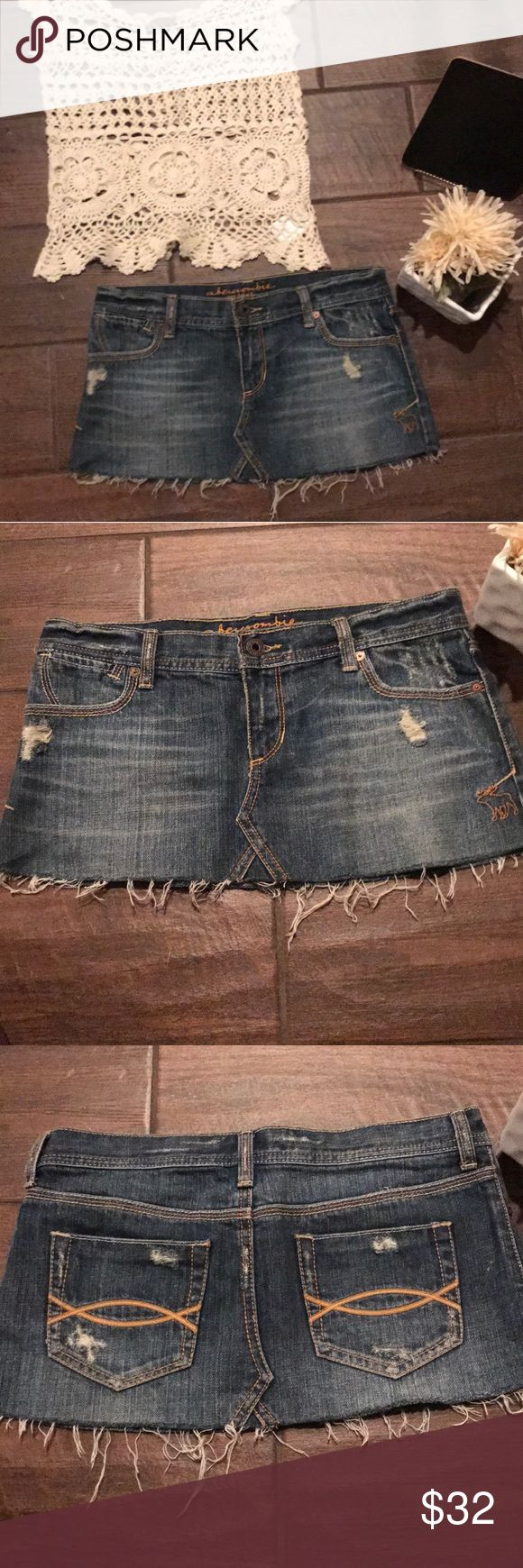 Blue jean Mini Skirt 💕 His blue jean mini skirt is distressed at the bottom. There are no stains or holes. The skirt is 9 inches from top to bottom hem. The top is also in our closet. Shop the entire look. 💕 Abercrombie & Fitch Skirts Mini
