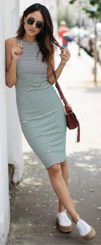 Stripes + essential this summer + Soraya Bakhtiar's flattering dress + platform sneakers + statement sunglasses + effortless seasonal outfit + Perfect for any occasion Dress: Urban Outfitters, Sneakers: Superga, Sunglasses: Spektre