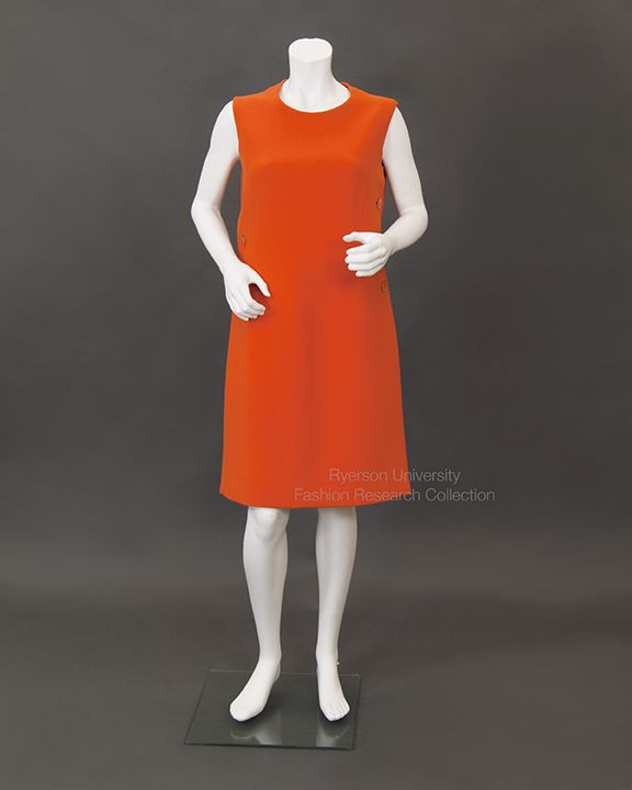 Orange Wool Sleeveless Dress with front panel and buttoned side closures, back zipper and back belt. c.1960s by Guy Laroche Paris Made in France FRC1986.01.21