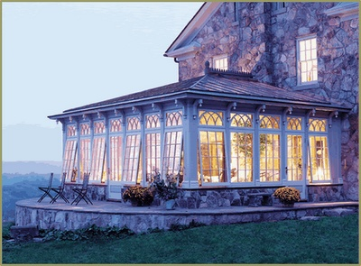 This is a stunning sun porch, but I can't help thinking it would be an ideal space for sewing and quilting.