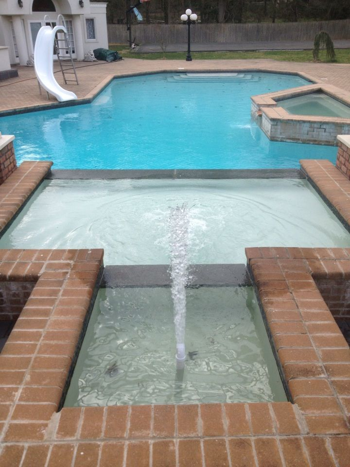 Attached Swimming Pool : Spill over spa and water feature attached to a swimming