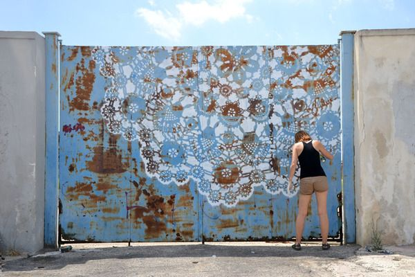 Polish artist NeSpoon combines lace-making, ceramics and street art. The result are stunning pieces in which the innocent beauty and intimacy of old-fashioned lace is contrasted to rugged and not-so-innocent urban decay. The City Stadium gates in Grottaglie, Italy, is one of her projects, made during the Fame Festival 2011