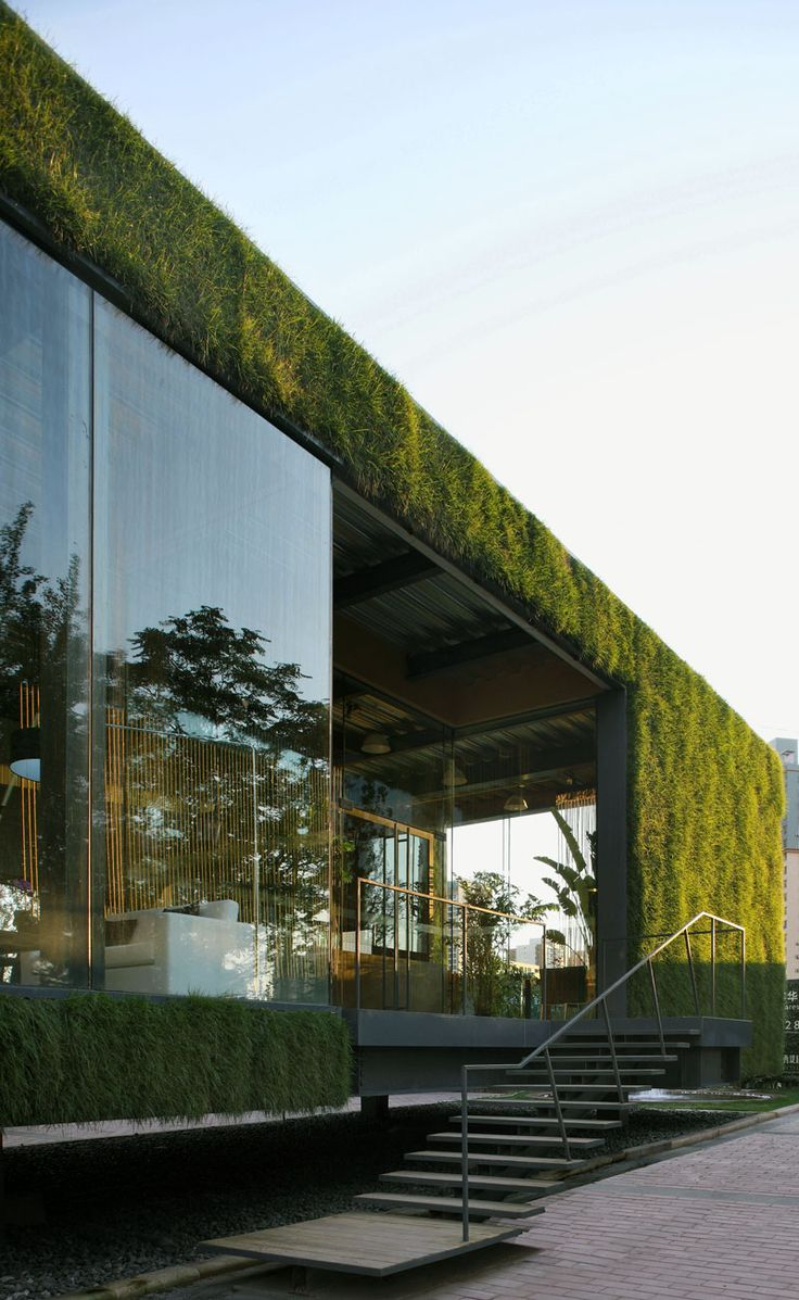 #GreenTechnologyShowroom #vertical grass wall and roof
