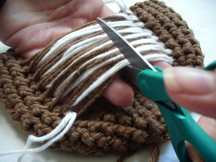 how to crochet with 2 colors of yarn, using a technique called stranding. This technique works wonderfully when there are only a few stitches between color changes..