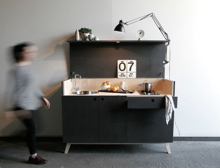 """""""Amanda"""" in a mini Kitchen which becomes a nice cabinet. Black mdf and birch plywood."""