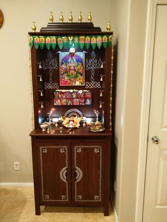 """Tejaswi and Kalyan write, """"Thank you Shyama for the wonderful idea. May god bless you. We loved it and enjoyed making one for our new home which we just moved in."""" They've used curtain finials from Micheals as toppers and and the spare holes in shelf for bells."""