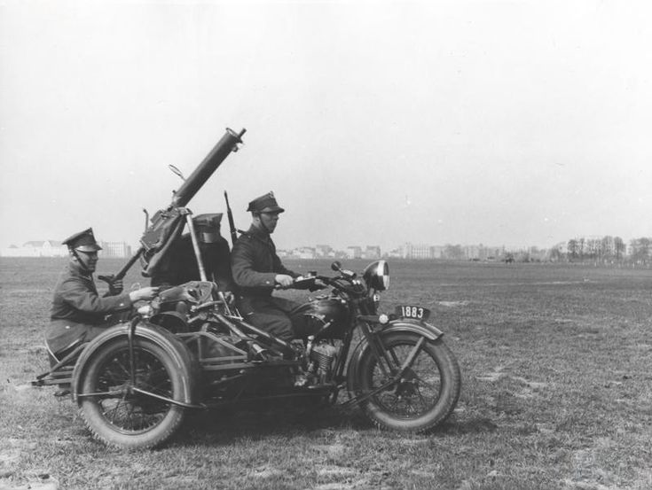 Late 1930s. Polish soldiers driving a Sokół 1000 Motorcycle with sidecar equipped with a Ckm wz. 30 Heavy Machine Gun in an Anti-Aircraft mount.