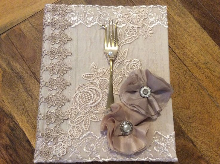 Handmade shabby chic recipe book decorated with lace appliqués and trims.