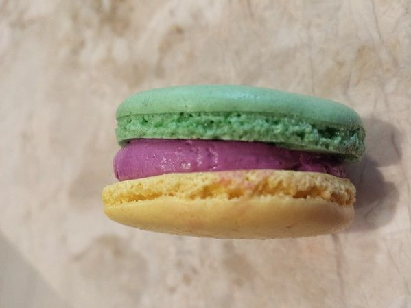 King cake-flavored treats in New Orleans for the king cake obsessed: Sucre's Mardi Gras macaron.