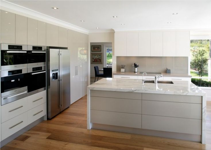 Interior, Contemporary Design Kitchen Island With Modern Kitchen Cabinets Furnished With Ovens And Refrigerator Completed With Applying White Large Marble Kitchen Table: Design a Kitchen:  Decorate Your Own Kitchen
