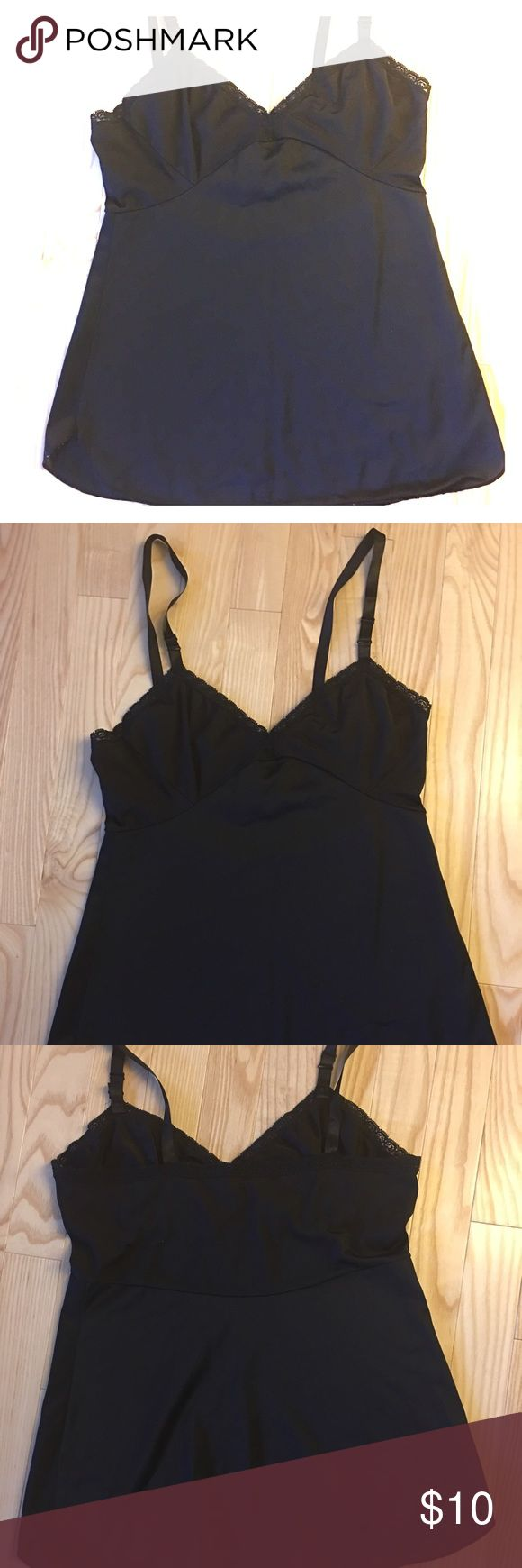Vintage black cami with adjustable straps This is a super sleek and cute vintage black camisole with adjustable straps size 34, nice to wear under a see through blouse or just alone , on trend Vintage Tops Camisoles