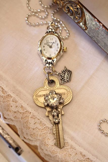 Vintage ladies watch faces added to the key as part of pendant. I LOVE this. Love the look of old watches as pendants! This would be an awesome way to use my mom's old watch.