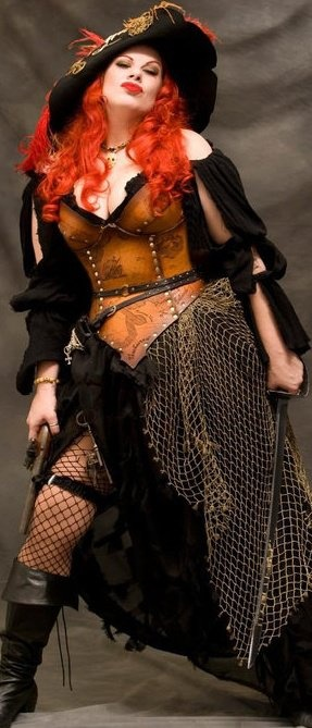 This was kind of the slutty fantasy look which inspired my 18th century/modern costume I created for my version of voodoo girl. The confident stance and the split up the skirt really caught my eye.