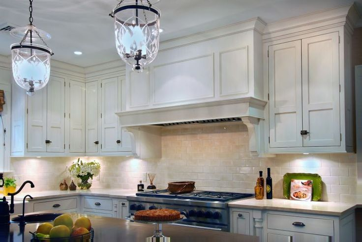 White Cabinetry With Lantern Pendant Lighting