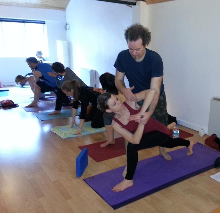 Adjusting Tiziana in Reverse Extreme sides ways Stretch. YTTC teacher training course. www.yogaireland.com