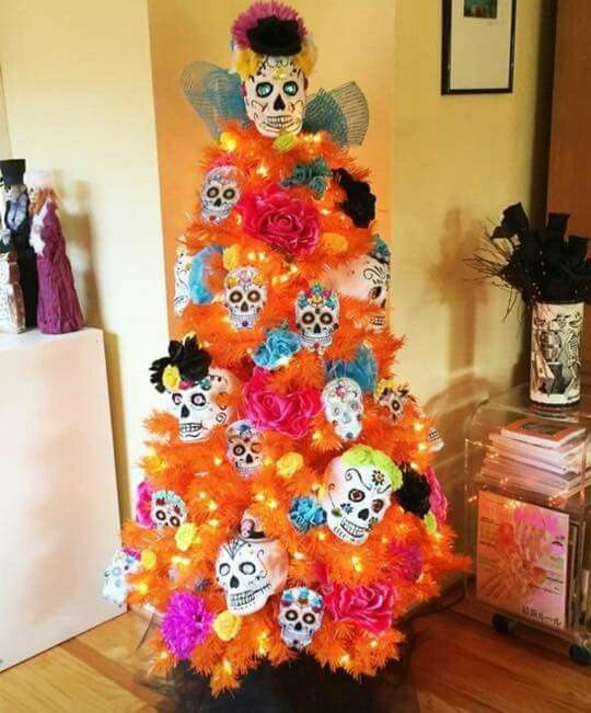 A Dia de Los Muertos tree. I would like to find a black tree that I could put up for halloween and decorate for thanksgiving and christmas too.