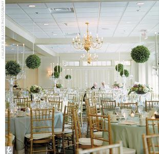 Garden feel reception decor. The tables have birds nests, fruit, ivy, roses and dahlias.