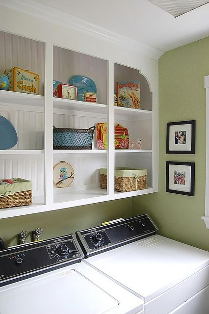 storage idea for laundry room: take the droopy doors off, add paneling to back, paint white.