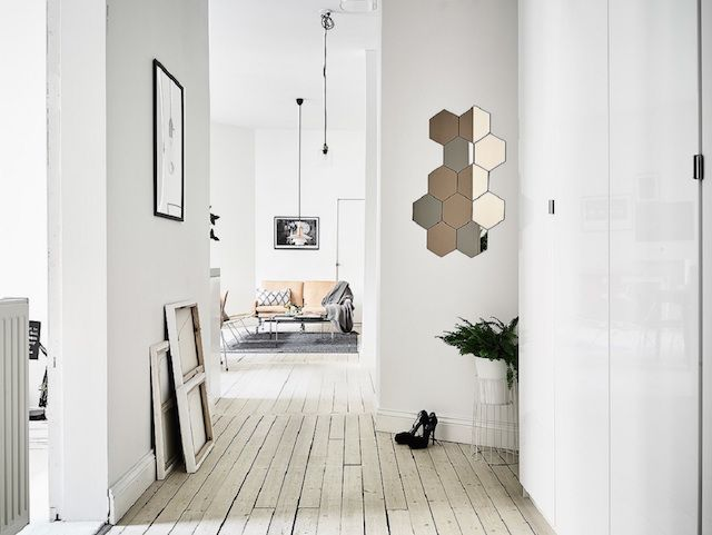 Hexigon mirror in the hallway of a calm Swedish space in neutrals