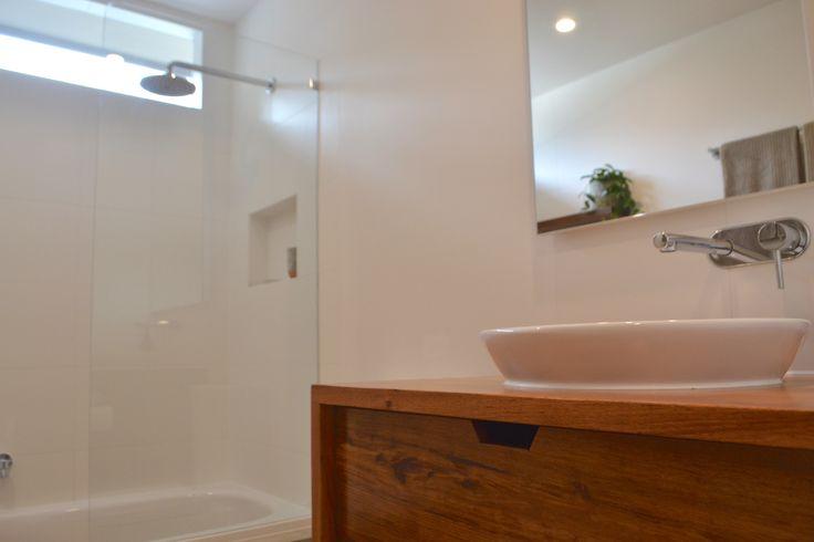 Timber (Tasmanian Blackwood) vanity with caroma Leda vasque inset basin. Custom built in mirrored cupboard