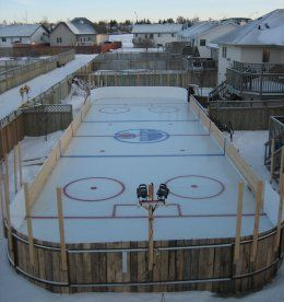 This huge backyard ice hockey rink is in Sylvan Lake Alberta, Canada. Its the creation of Shane Cyrenne and his neighbor Chris McNeil. 9000 gallons of water was used to make the rink, and 70 hours in the shop to build the mini-Zamboni.