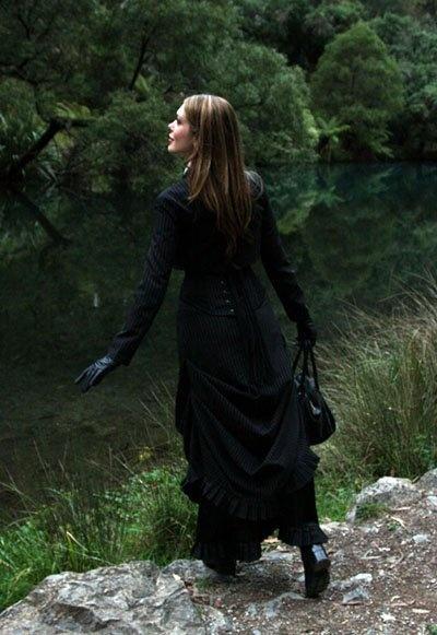 Pandora English creator Tara Moss swathed in Kambriel couture in her misty backyard wonderland. Photographed by Elizabeth Allnutt.