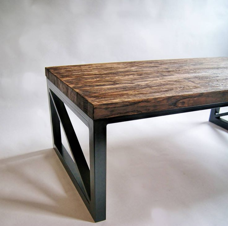 Sturdy, industrial steel construction and carefully stained and aged / antiqued noble oak solid wood tabletop.