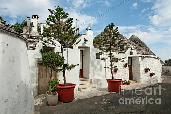 Typical beautiful Trulli houses in Alberobello under a blue sky, Puglia, Italy