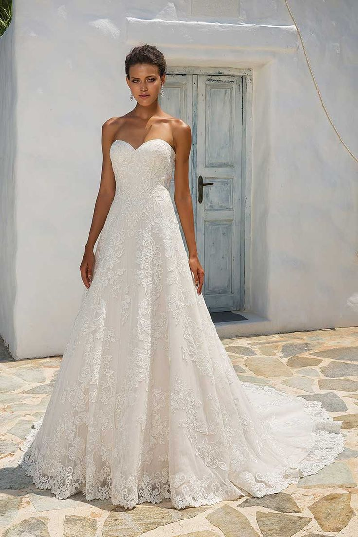 Justin Alexander 8955 Wedding Dress - Mia Sposa Bridal Boutique. Justin Alexander 8955 Wedding Dress. Lace Appliqué on Point d'Esprit A-line Gown with Short Sleeves  Vintage inspired Point d'esprit tulle accented by embroidered lace. Hand placed lace finishes the hem of this A-line gown.