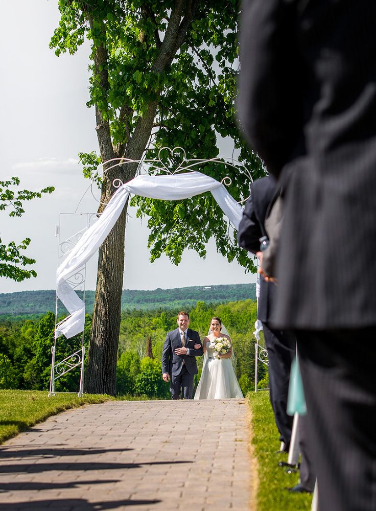Bride walking aisle at Tangle Creek Golf and Country Club photo by Vaughn Barry Photography www.vaughnbarry.com | Barrie Wedding Photographer