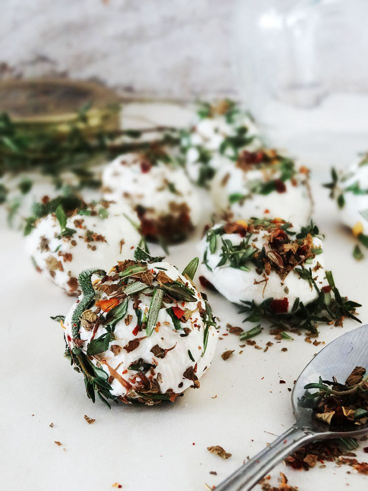Marinated goat cheese with thyme, rosemary and olive oil