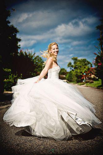 Bride twirling around in dress portrait