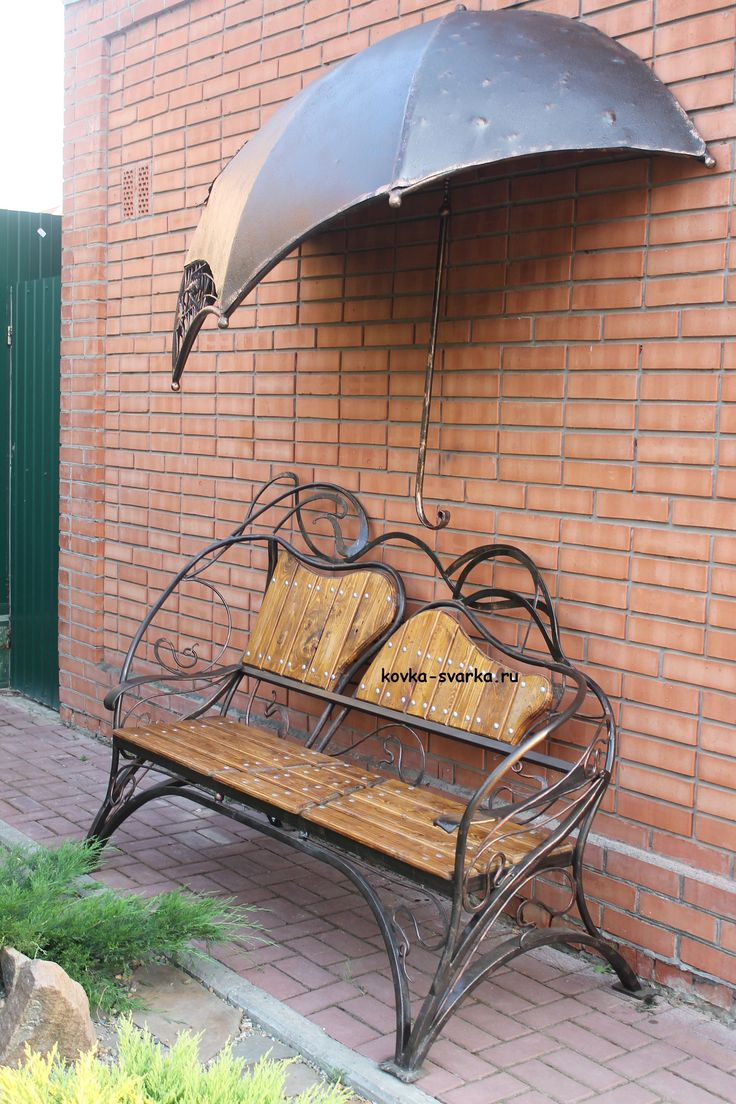 wrought-iron bench under a canopy