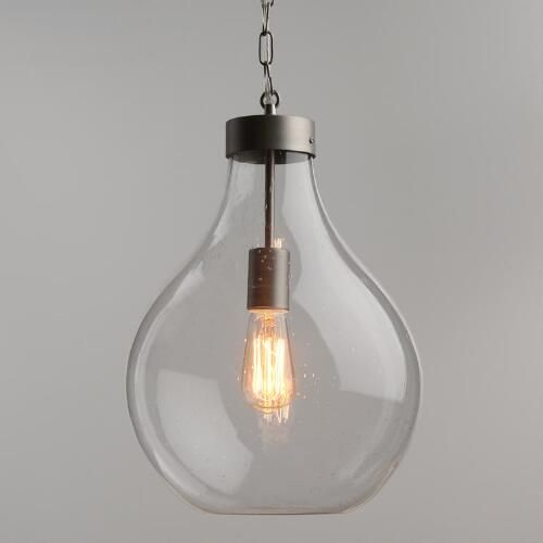 Our exclusive pendant is crafted of vintage-style seeded glass in a voluptuous teardrop shape with natural variations that make each piece unique. Complement its unique texture with one of our vintage-style filament bulbs and fill the room with a warm glow.
