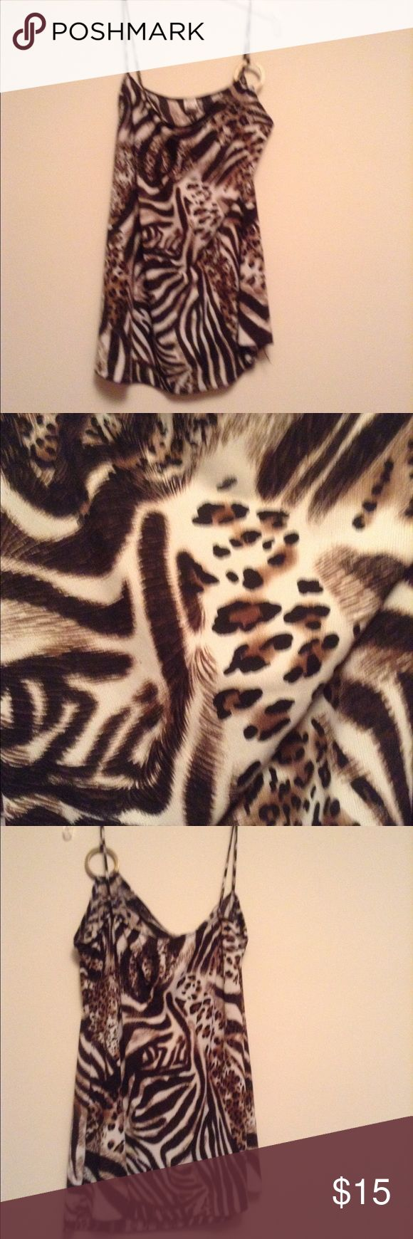 Strappy Animal Print Top This slinky animal print top is perfect for a casual night out. Tops Camisoles