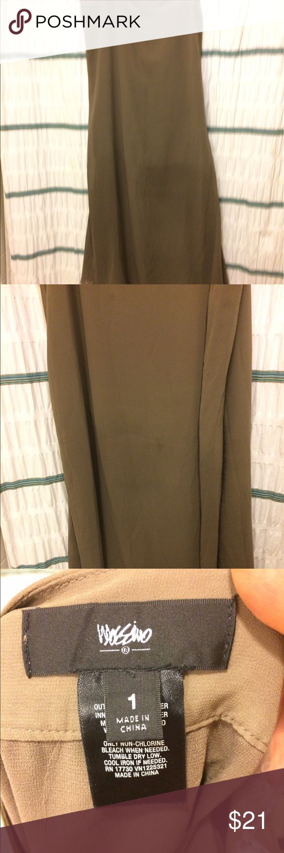 Tan maxi skirt. hidden side zipper and side slots. Tan maxi skirt with hidden zipper, side slots and built in have slip. Fabric is shirt. Skirts Maxi