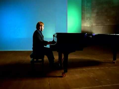Elton John - Something About The Way You Look Tonight...this WILL be my wedding song (: