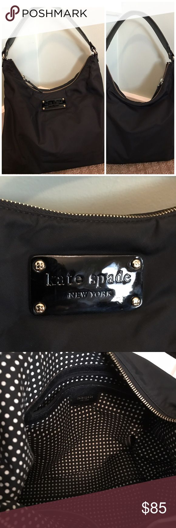 "Kate Spade Classic Black Bag Black Nylon satchel with shoulder strap. This is a durable basic black bag that is quite versatile. Clean inside and out. Kate Spade signature logo in the lining and outside the purse. Signature polkadot lining. 13.5 x 12.5"" One zipper and two slip pockets on the inside. kate spade Bags Shoulder Bags"