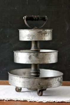 3-Tier Art Supply Desk Organizer from Vintage Cake Pans by seelamade love the shovel handle + casters!