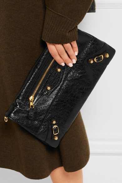 Black textured-leather (Lamb) Snap-fastening front flap Comes with dust bag Weighs approximately 1.5lbs/ 0.7kg