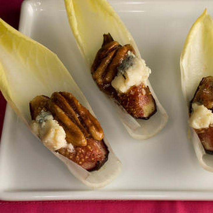 Endive with Figs, Blue Cheese, and Pecans Recipe Appetizers with unsalted butter, pecan halves, granulated sugar, light brown sugar, maple syrup, figs, extra-virgin olive oil, salt, ground black pepper, Belgian endive, crumbled blue cheese