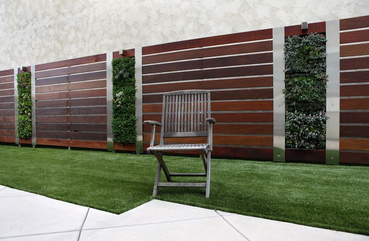 Vertical garden design by Roxanne Kim-Perez, Better Landscape and Gardens. Materials used - Ipe wood, stainless steel, aluminum posts, succulents