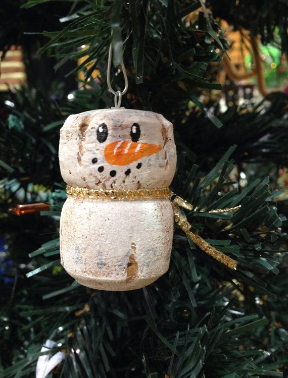 Looking for a snowy friend for your Christmas tree this year? Add a little cheer with a champagne cork snowman! Each snowman ornament measures