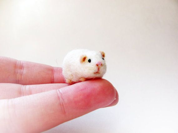 This goes beyond craft into art.  Miniature guinea pig by HandmadeByNovember on Etsy, $15.00