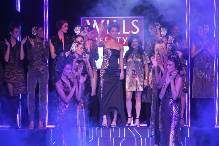 Namrata Joshipura and Kangana Ranaut acknowledge the ovation from the crowd as the models cheer on.