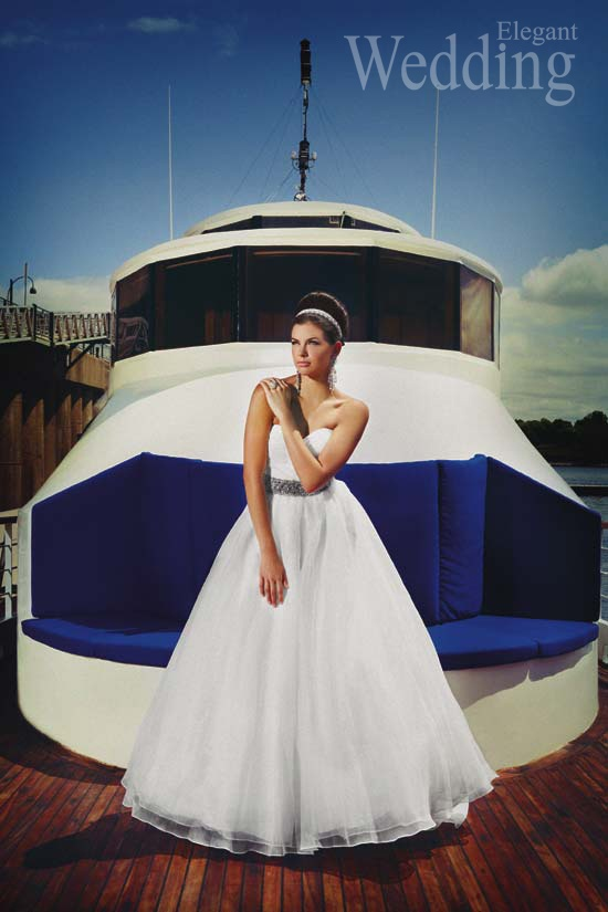 Our silk organza ball gown featured in Elegant Wedding Montreal magazine.