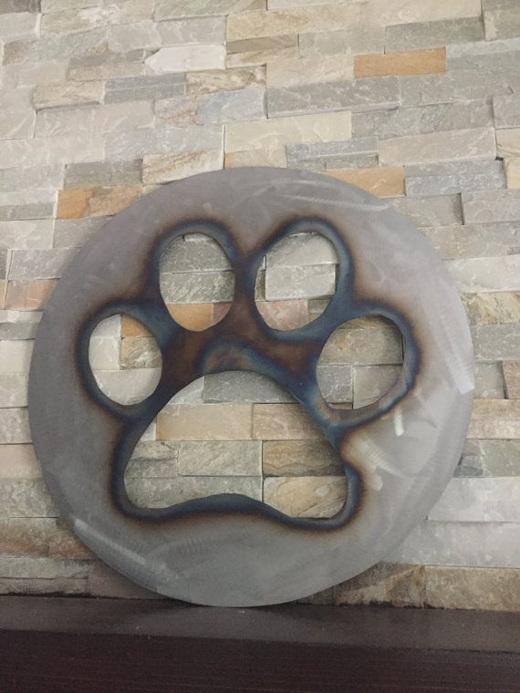 SOLD, but could be made to order  PAW PRINT Rustic wall art sign...Fun, Rustic decor wall art. All decor, wall art is made from reclaimed pallet wood & steel. Years of weather & use creates a rustic look that simply can not be duplicated...so each piece is unique with nail holes, nails, splits, grains, knots & character  The metal sign is made of steel that I free hand by using a plasma cutting machine. All of my creations are made with passion & love. I try to bring a po...