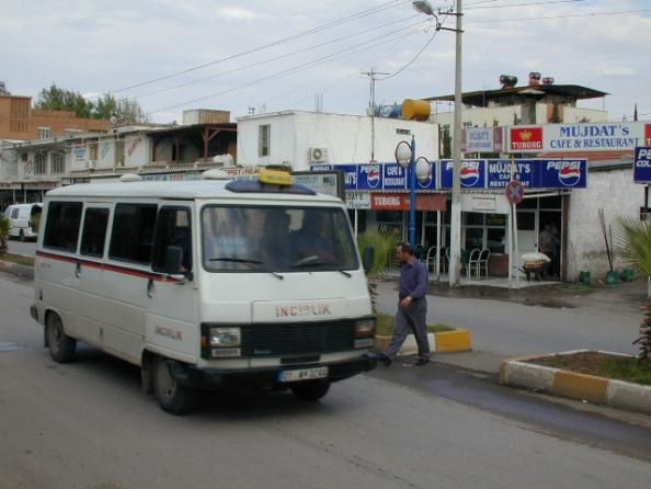 Dolmus (Turkish bus) in incerlik with mudjats in the background